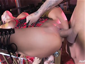 Asa Akira gets smashed on top of a caged Sophia Santi