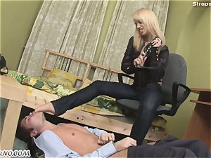 evil towheaded in a leather suit punishes her hookup marionette