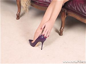 ash-blonde undresses off underwear and solos in nylons and stilettos