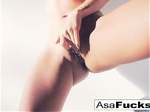 Asa Akira uses a faux arm to please her pussy