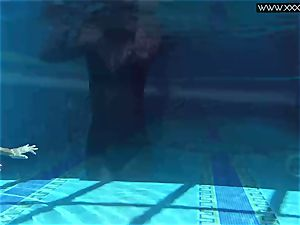Tiffany Tatum strips nude underwater